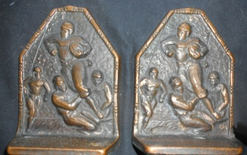 Image for CAST IRON FOOTBALL BOOKENDS. RARE.  $250.00